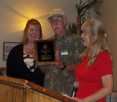 """Renee Rau (left) and Francine Stevens (right) and Howard Lubel, the 2015 Mel Finn award recipient. Howard has served on the Board as a member, Board Secretary, and 2011 President. He also served as inaugural Chair of Resource Management. He continues to do what he loves the most – working and volunteering steadfastly """"boots on"""" in the Park, under the direction of the Park manager."""
