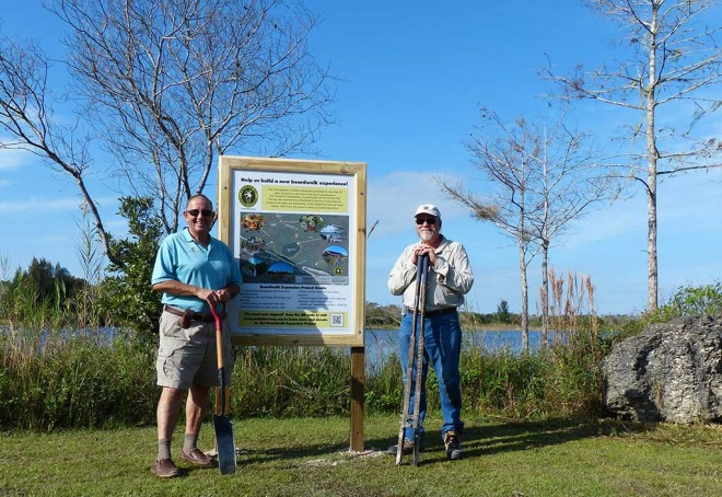 FOF volunteers Steve Koreny and Patrick Higgins just after they finished erecting the first of two new signs launching our Big Cypress Bend Boardwalk expansion project appeal. One is located where our tram tours start on Janes Scenic Drive and the other by the iron ranger at the boardwalk site. The signs have a map of our vision for the expanded site and will be will be used as talking points on our tours to raise awareness of the project, as well as to solicit donations.  The signs have an embedded QR code that, when scanned on a smart phone, takes the viewer directly to the projects page on our website where they can learn more and make a donation.
