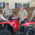 Park staffers admire the new Honda ATV acquired with funds from the FOF annual fund campaign. From left to right are: park services specialist Steve Houseknecht, ranger Steven Bass, biologist Mike Owen and ranger Tom Mosley.