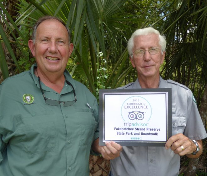 Naturalists Patrick Higgins and Glen Stacell display 2016 TripAdvisor certificate of excellence